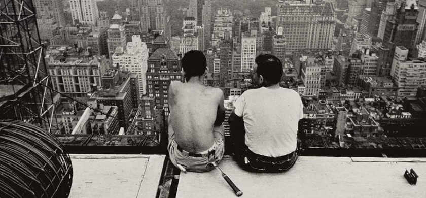 two-men-sitting-on-a-scaffold-overlooking-manhattan-nat-herz.jpg